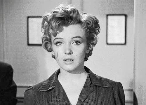 Watch and share Marilyn Monroe GIFs and Sad Face GIFs on Gfycat
