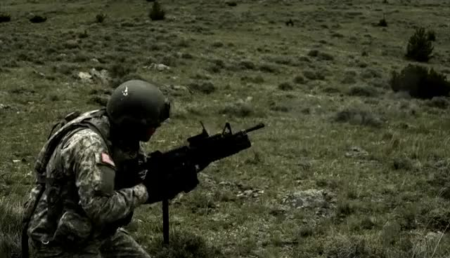 Watch and share Slow Motion Clip Of Soldier Firing 40mm Grenade Launcher While Kneeling. GIFs on Gfycat